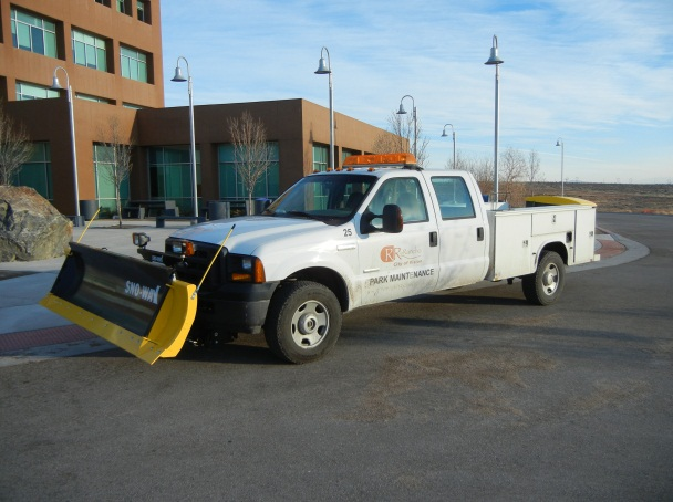 picture of city vehicle with plow