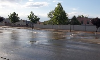 picture of major water leak in roadway